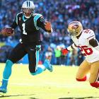 Cam Newton takes off under pressure by Tramaine Brock.
