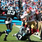 Michael Crabtree tries to get additional yardage after making a first-half reception.