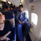Without the budget for chartered flights, the NMSU travel department makes booking exit row seating?with its extra legroom?a top priority for Tanveer (shown) and Sim.