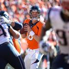 Peyton Manning completed 32 of 43 passes for 400 yards and two touchdowns in leading Denver to its first Super Bowl in 15 years.
