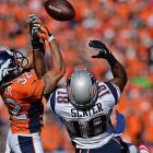 Tony Carter and Matthew Slater battle for the ball in a game in which neither quarterback threw an interception.