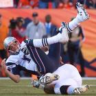 The Broncos sacked Tom Brady twice and held him to one touchdown pass as they earned a trip to the Super Bowl.