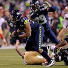 Michael Bennett heads upfield after recovering a Colin Kaepernick fumble.