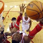 Houston Rockets center Dwight Howard tries to score as two Milwaukee Bucks defenders look on. The Rockets won Saturday's contest 114-104.