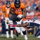 Denver running back Knowshon Moreno hurdles over a Patriots defender during Sunday's AFC Championship game in Denver. Moreno left the game with an injury to his ribs during the fourth quarter, but is expected to play in the Super Bowl.