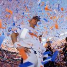 Peyton Manning celebrates Denver's 26-16 victory in the AFC Championship game over the Patriots. The Broncos will face the Seattle Seahawks in Super Bowl XLVIII on Feb. 2.