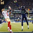 Seattle cornerback Richard Sherman tips a pass intended for San Francisco 49ers wide receiver Michael Crabtree that was intercepted by Seahawks linebacker Malcolm Smith. The interception clinched a victory in the NFC Championship and sent Seattle to the Super Bowl.