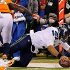 Russell Wilson is stopped short of a first down. He only ran the ball three times, finishing with 26 yards.
