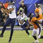 Malcolm Smith picks off the Manning pass....