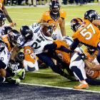 Marshawn Lynch pushes his way into the end zone for his only touchdown.