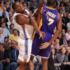 Ron Artest tries to pull a fast one by pinning Durant's arm during a game at the Ford Center.