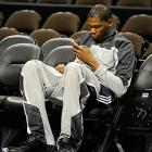 Durant enjoying a quiet moment before practice.