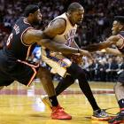 LeBron James and Norris Cole pressure Durant during Oklahoma City's visit to Miami. The Thunder won 112-95 behind Durant's 33 points.