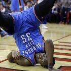 Durant flips on his head after being fouled by Houston Rockets' Aaron Brooks.