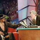 Leno presented Dennis Rodman with a pair of high-heeled basketball shoes during one of his many visits to the show.