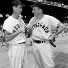 Ted Williams talks with Ralph Kiner before the start of the All-Star game at Comiskey Park in Chicago on July 11, 1950.