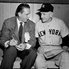 Ralph Kiner chats with Casey Stengel, manager of the New York Yankees, in the dugout at Ebbets Field in Brooklyn before the start of the World Series on Oct. 1, 1952.