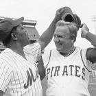 Willie Mays tries to get Ralph Kiner's hat as the two Hall of Famers pose for pictures before the start of the Old Timers Day game at Shea Stadium in New York on Aug. 14, 1982.