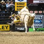 """Bullrider Cody Brown is flung off Hey Now during the Professional Bull Riders """"LiftMaster Chute Out"""" in Anaheim, Calif."""