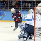 Jocelyne Lamoureux of the U.S. shoots during a Saturday game against Finland. The Americans won 3-1.