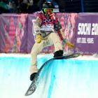 Shaun White hits the edge of the halfpipe during the finals on Tuesday.