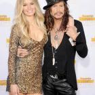 Aerosmith's lead crooner, who is old enough to remember the first SI Swimsuit issue, offered some support to Ms. Miller, who happens to be a model citizen, at the mag's 50th Anniversary shindig in Hollywood.