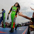 Casey Mears and Danica Patrick exchange high fives with fans.