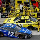 Ricky Stenhouse Jr. pulls out of his pit as Matt Kenseth sits facing backwards in his pit box in an unusual chain of events.