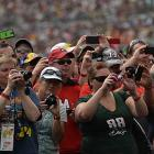 Fans snapped up shots during the pre-race ceremonies.