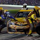 Kyle Busch's pit crew works its magic under the night sky of Daytona.