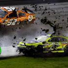 Paul Menard's car kicks up some mud during a wreck that damaged several cars with a little over 50 laps to go.