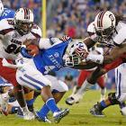 Clowney brings down Kentucky Wildcats running back Raymond Sanders for a loss.