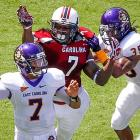 Clowney pressures East Carolina quarterback Rio Johnson.