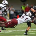 Clowney dives to stop Vanderbilt quarterback Jordan Rodgers.
