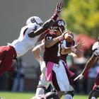 Clowney bears down on Mississippi State quarterback Tyler Russell.