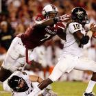 Clowney sacks Vanderbilt quarterback Larry Smith, causing a fumble.