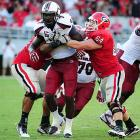 Clowney rushes against Cordy Glenn and Dallas Lee of Georgia.
