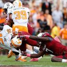 Clowney nearly rips off the helmet of Marlin Lane of Tennessee.