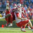 Clowney gets airborne as he sacks Arkansas quarterback Tyler Wilson.