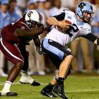 Clowney tries to sack Bryn Renner of North Carolina.