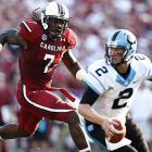 Clowney chases Bryn Renner of the North Carolina Tar Heels.