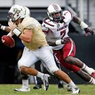 Blake Bortles of Central Florida is pressured by Clowney.