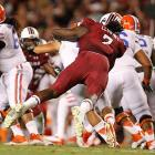 Clowney tackles Trey Burton of the Florida Gators.
