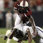 Jordan Davis of East Carolina tries to stop Clowney.