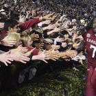 Clowney celebrates with fans after defeating Clemson 31-17.