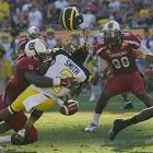 Clowney tackles, forces a fumble and then recovers the fumble -- all while knocking the helmet off of Michigan running back Vincent Smith. The hit set up a touchdown pass to wide receiver Ace Sanders for a 27-22 lead. South Carolina went on to win the 2013 Outback Bowl by the score of 33-28.