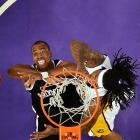 Brooklyn Nets center Jason Collins battles for a rebound against the Los Angeles Lakers on Sunday. Collins's appearance for the Nets on Sunday marked the first occasion an openly gay athlete had participated in one of North America's four major professional sports.