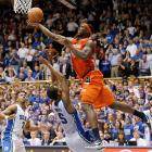 C.J. Fair of Syracuse is called for a charge against Duke as he sinks what would have been the game-tying layup in the game's waning seconds. The basket was waved off, and the controversial call caused Syracuse coach Jim Boeheim to rush the court to argue with the referee, which led to his ejection. Duke won 66-60.