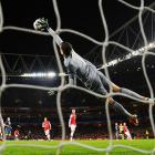 Arsenal goalkeeper Wojciech Szczesny stretches to make a save during a UEFA Champions League match against Bayern Munich. Szczesny was sent off for a red card in the first half and Bayern won 2-0, putting the defending European champions in good position to advance to the next round.