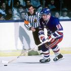 The brilliant scorer and playmaker was brought in from the Kings with a stretch drive trade in March 1987. At 35 and in his 16th season, the six-time 50-goal man added major starpower to a lineup that included such Broadway stalwarts as Ron Duguay, Ron Greschner, Pierre Larouche, Don Maloney, James Patrick, and John Vanbiesbrouck. Dionne squeezed out a goal and an assist in six playoff games before the Rangers were dispatched to the golf course by the Flyers. New York failed to qualify the following season even though Dionne lit the lamp 31 times (second on the team behind Walt Poddubny's 38). Joining forces with ex-Les Glorieux geezer Guy Lafleur for 1988-89, Dionne helped the Blueshirts return to the postseason where they were swept by Pittsburgh, thus concluding his Hall of Fame career. <bold>Notable Rangers during Dionne's tenure:</bold> Ron Duguay, John Vanbiesbrouck, Brian Leetch, Guy LaFleur